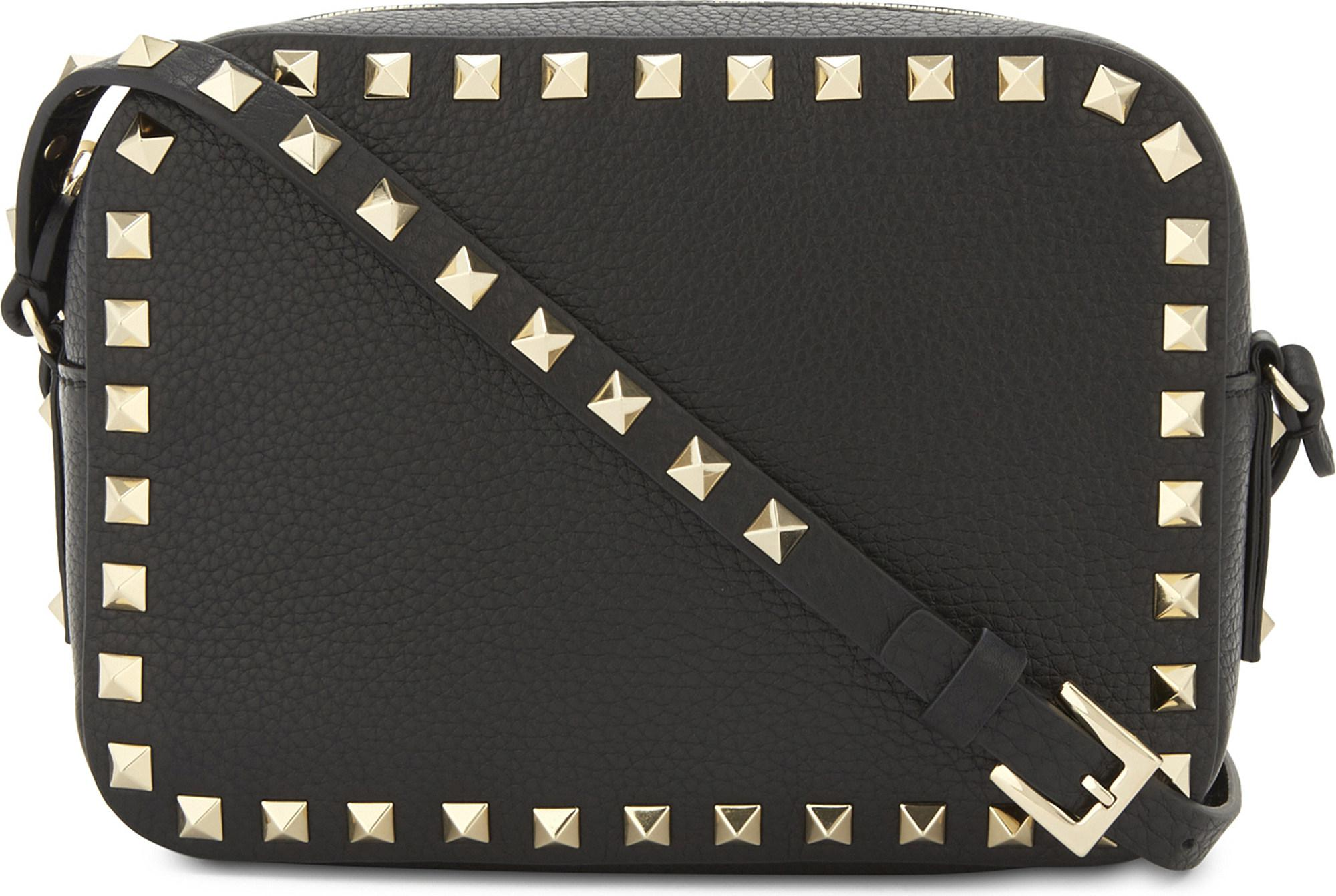 8ab6ee47a1 Lyst - Valentino Rockstud Leather Camera Cross-body Bag in Black