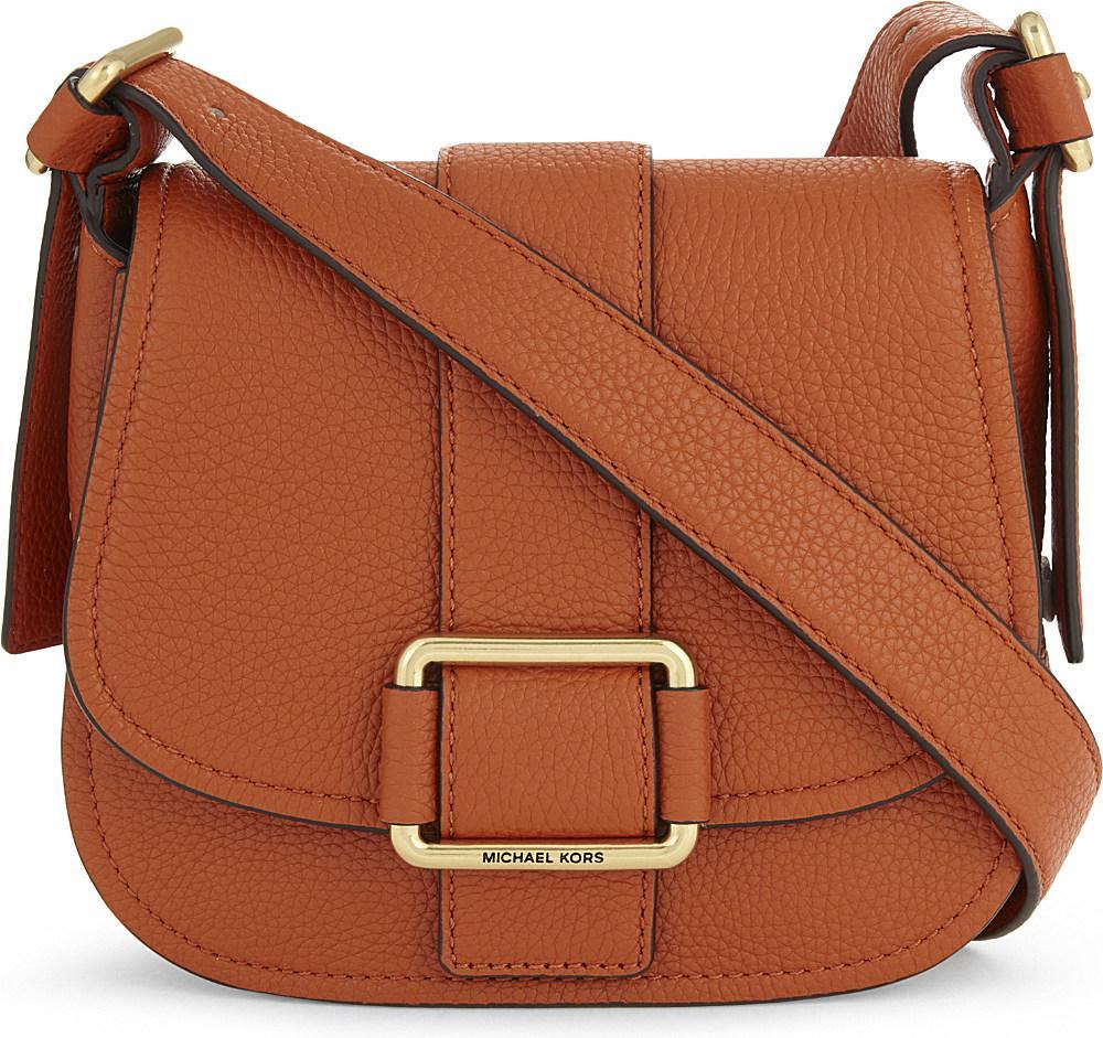 b42a2e4cf63 Lyst - MICHAEL Michael Kors Maxine Medium Grained Leather Saddle Bag ...