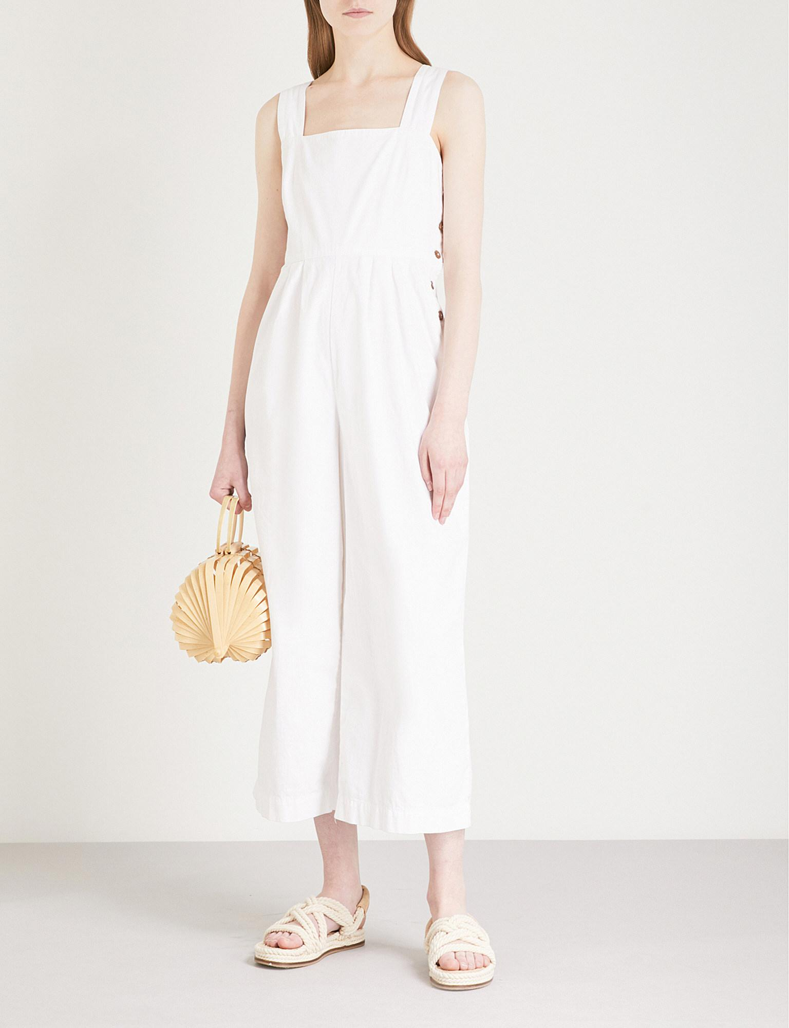 5961c5bc6dcf Free People Fara Button Up Cotton Jumpsuit in White - Lyst