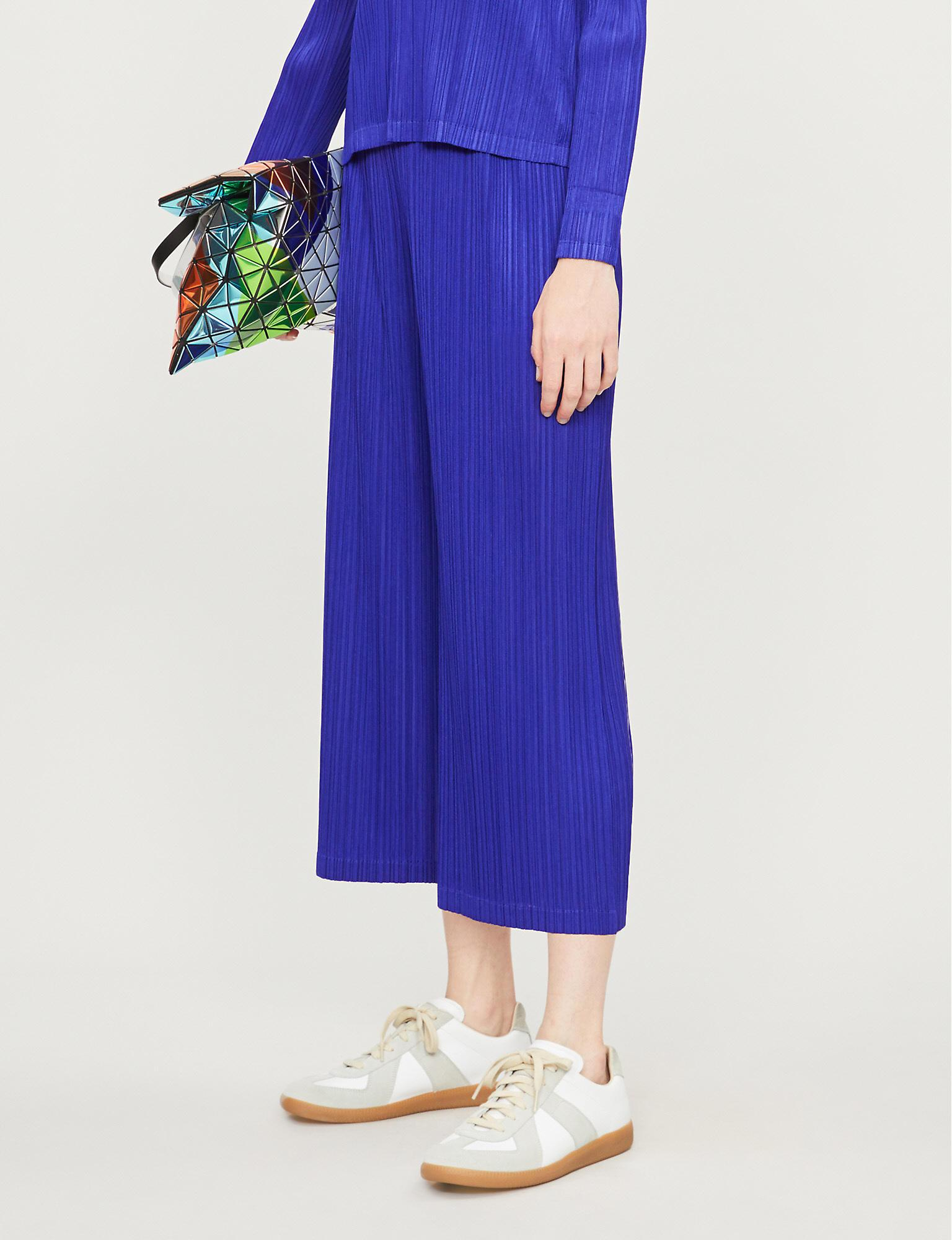 2c7f44755e Pleats Please Issey Miyake. Women's Blue Glass Cropped High-rise Pleated  Trousers