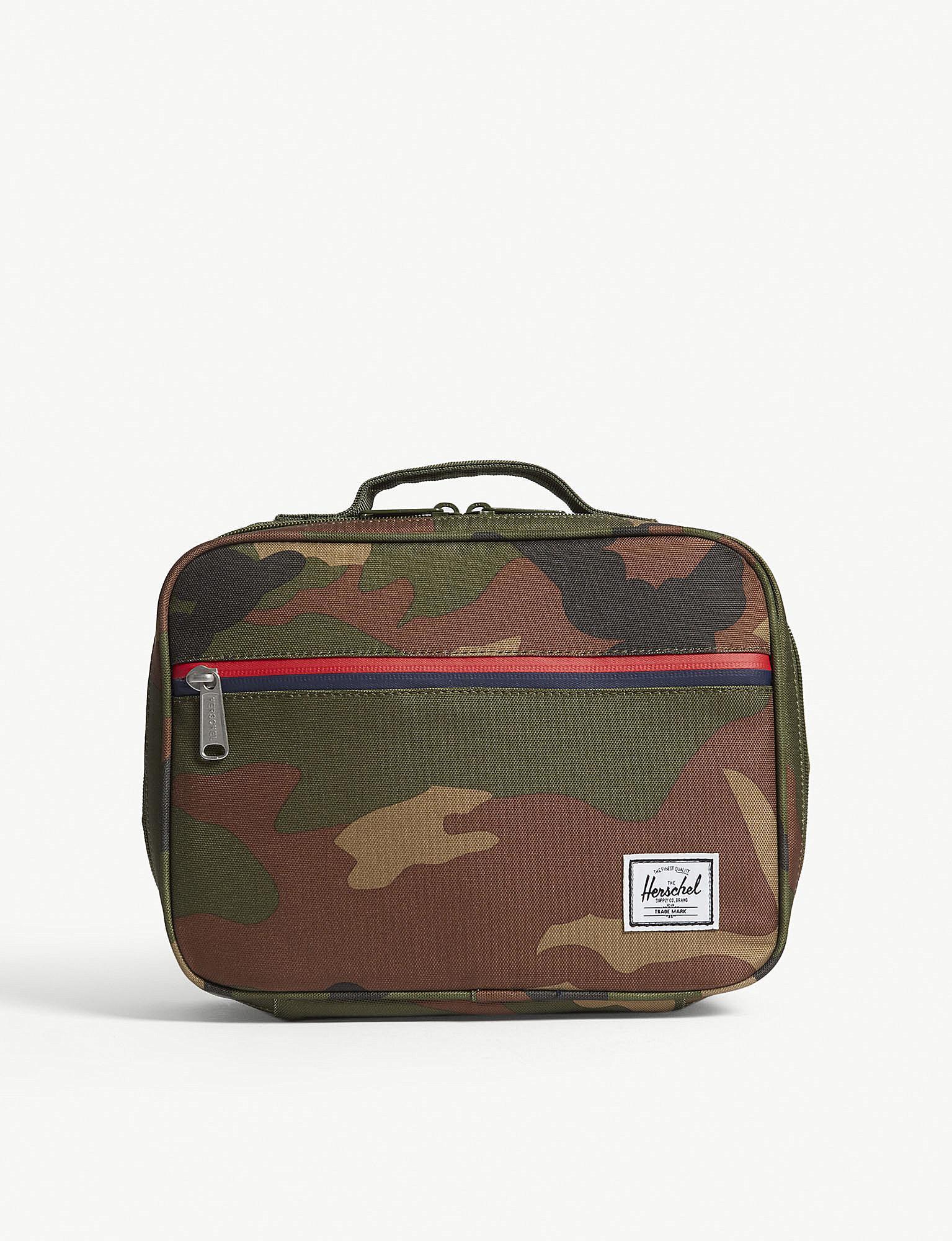 herschel supply co pop quiz camouflage lunch box in green lyst