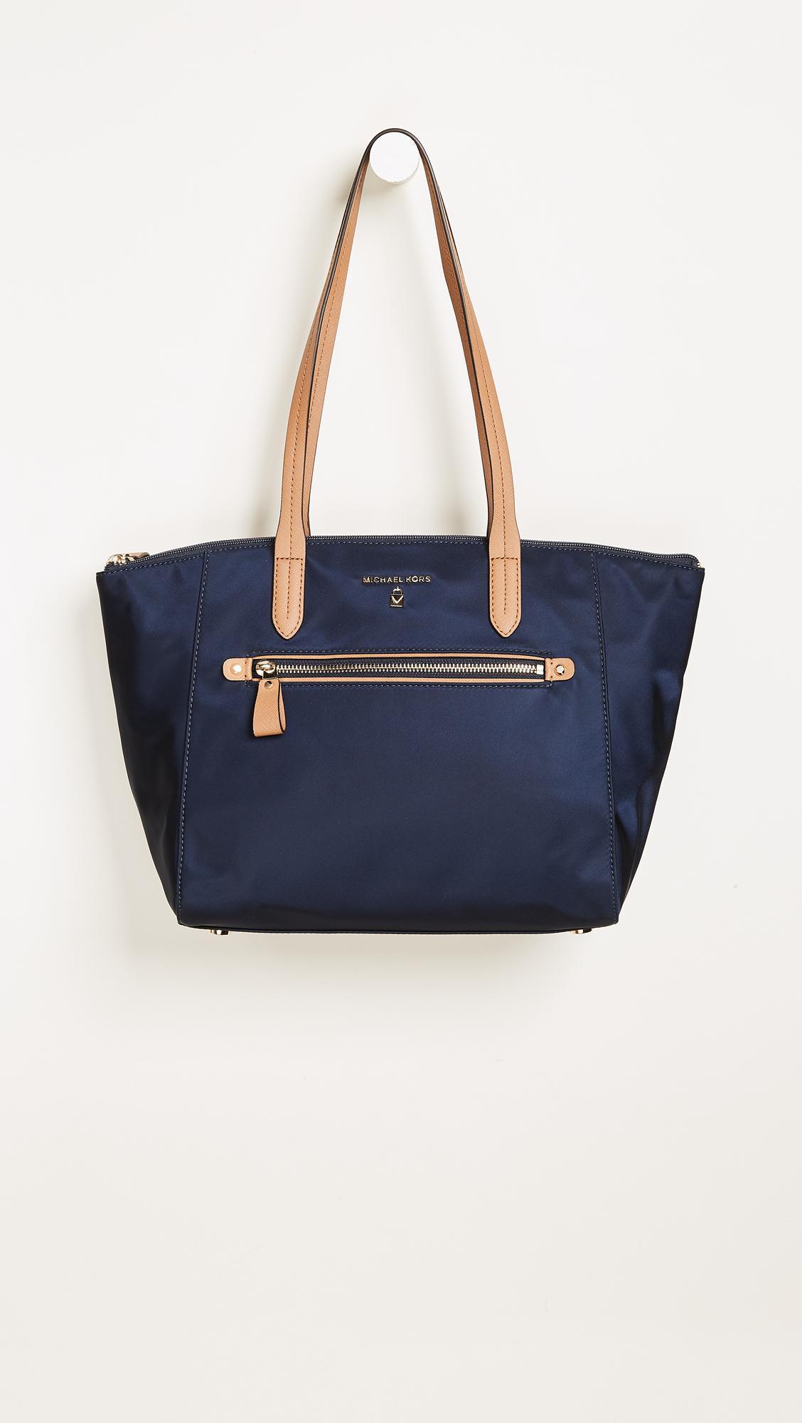 fb291f3b70b4 Lyst - MICHAEL Michael Kors Nylon Kelsey Medium Top Zip Tote in Blue