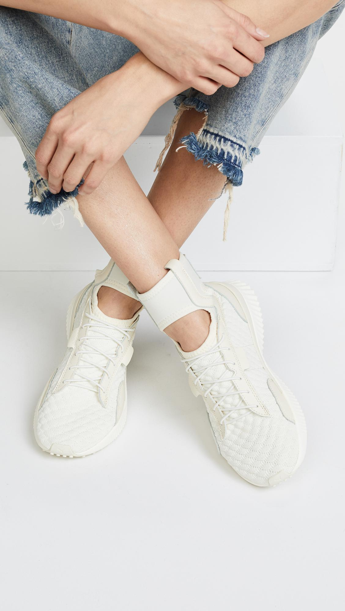 a4be75d170a3 Lyst - PUMA Fenty X Trainer Mid Geo Sneakers