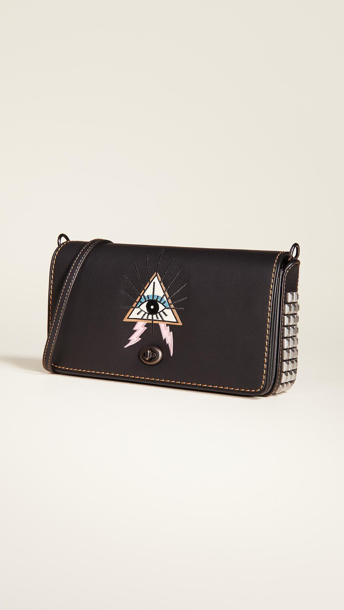 da088c640a5 Lyst - COACH Pyramid Eye Dinky Crossbody Bag in Black