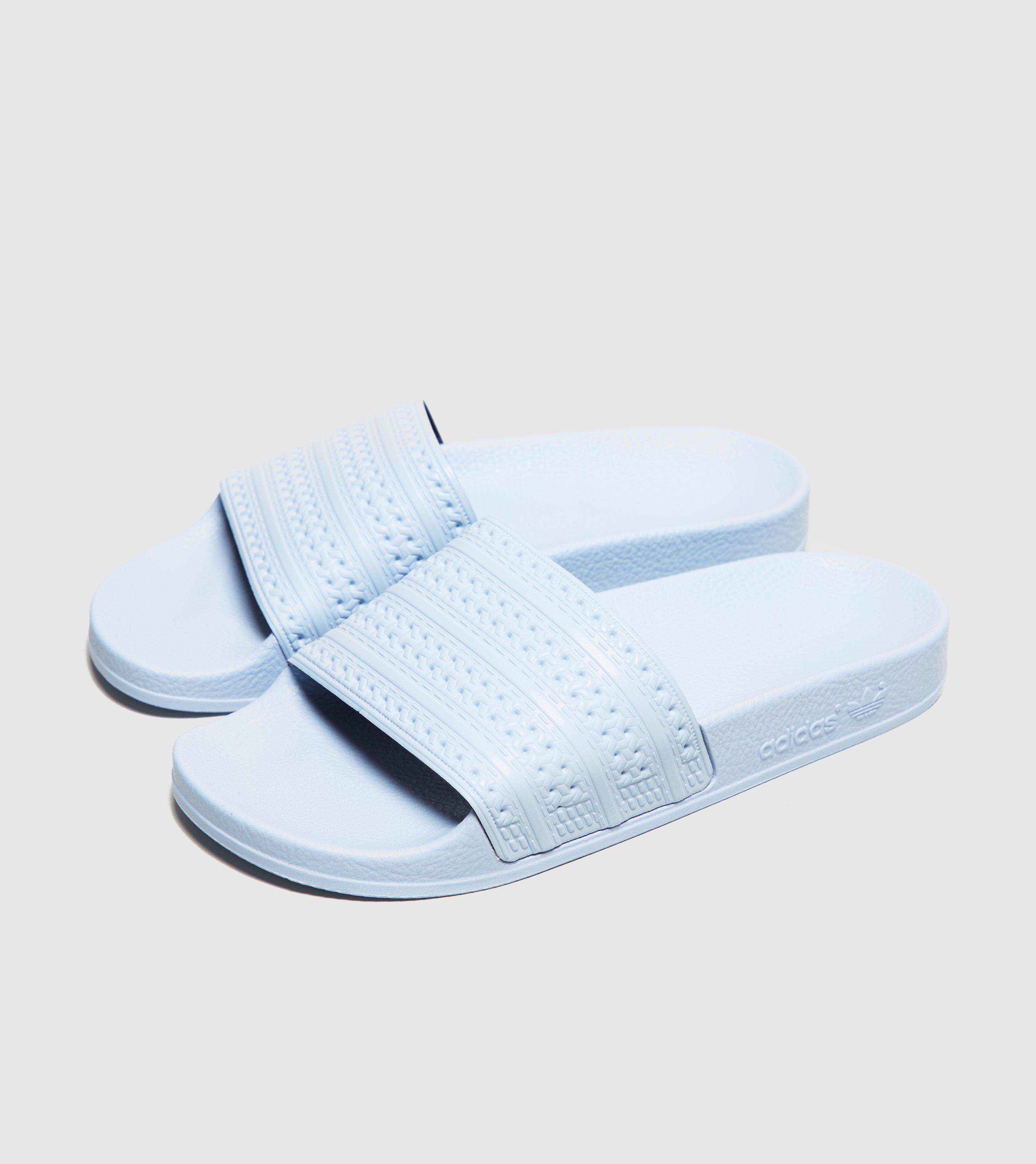 discount sale 59e86 8e06c adidas Originals Adilette Slides Women s in Blue - Lyst