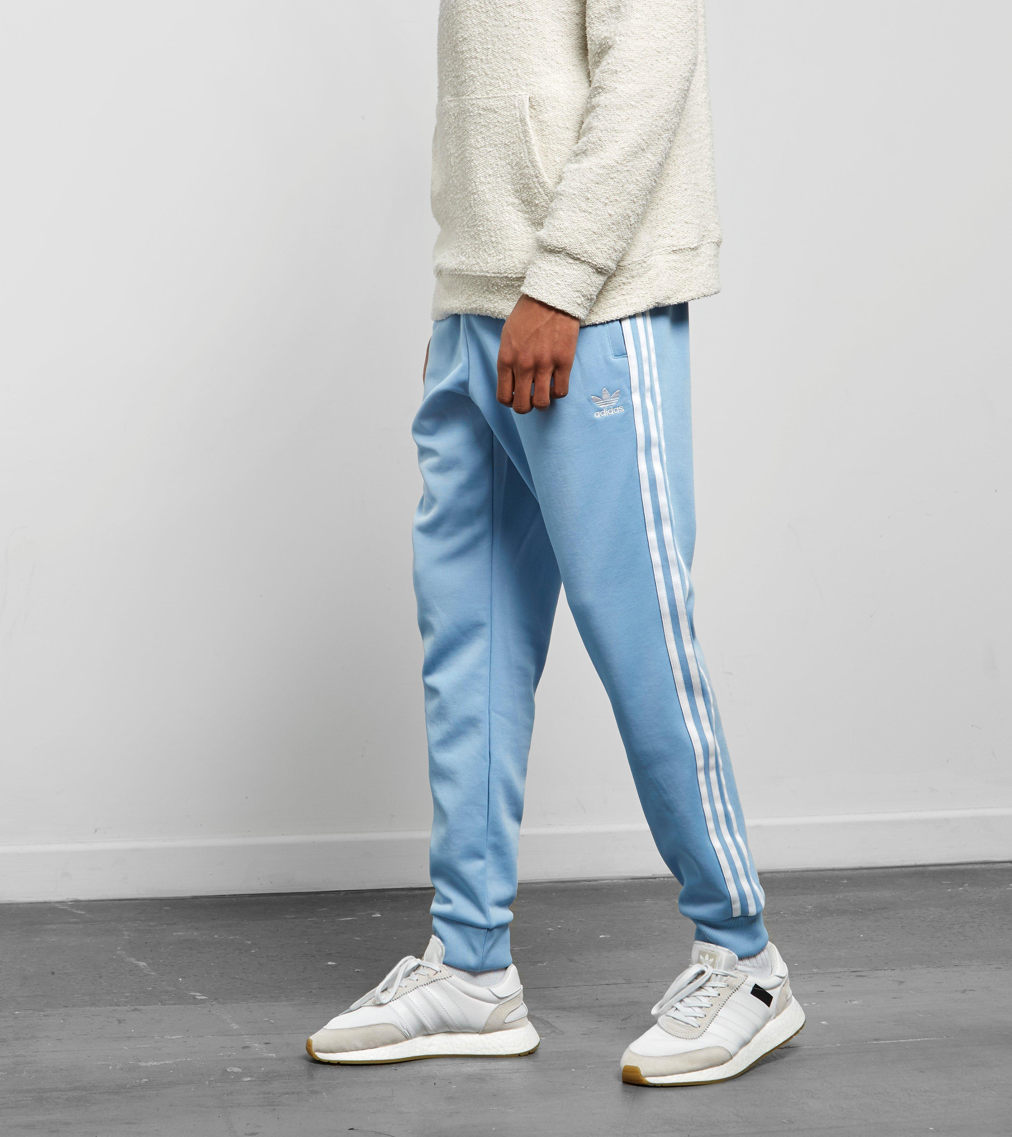 5b114438 adidas Originals Superstar Cuffed Track Pants in Blue for Men - Lyst