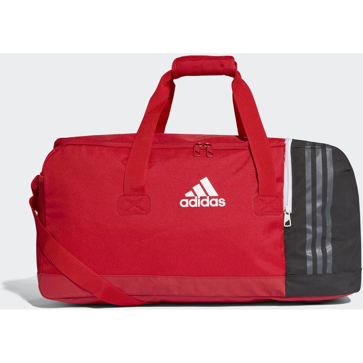 dac603fa7c Lyst - Sac de sport format moyen Tiro femmes Sac de sport en rouge ...