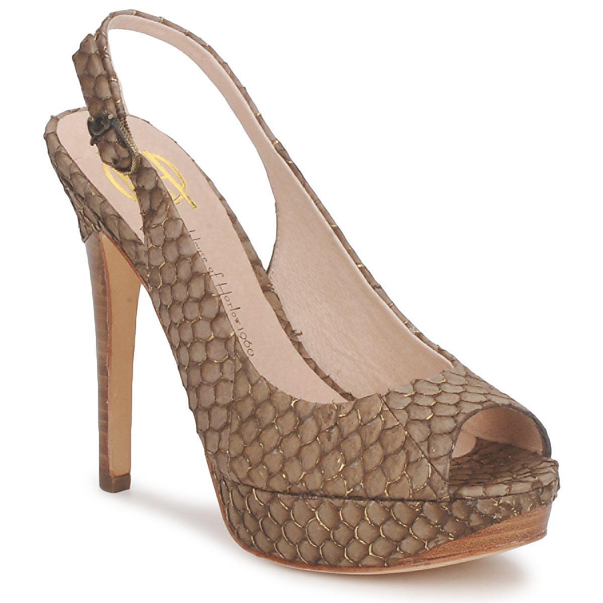 de248f3c3ab408 House of Harlow 1960 Nadya Women s Sandals In Brown in Brown - Lyst