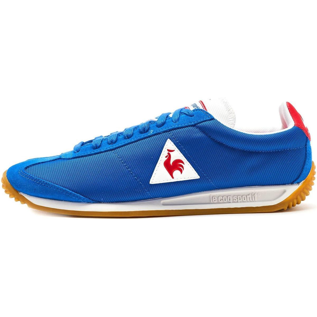 outlet store 634fd 11a2f Le Coq Sportif Quartz Nylon Gum Trainers In Classic Blue Vintage Red ...