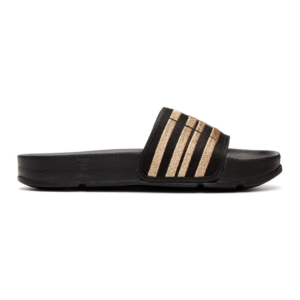 Charlotte Olympia Black & Gold Fila Edition Drifter Slides