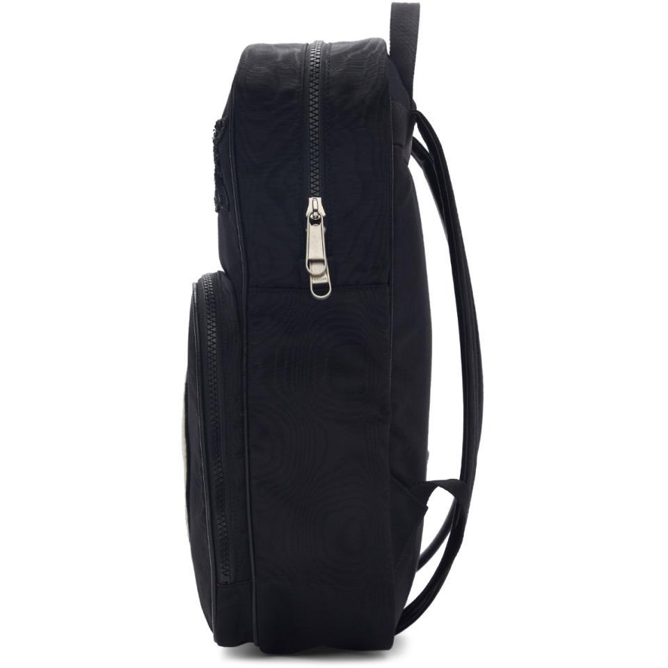 6de5f6bacf04 Gucci Black Medium Tenebre Logo Patch Backpack in Black - Save 44 ...