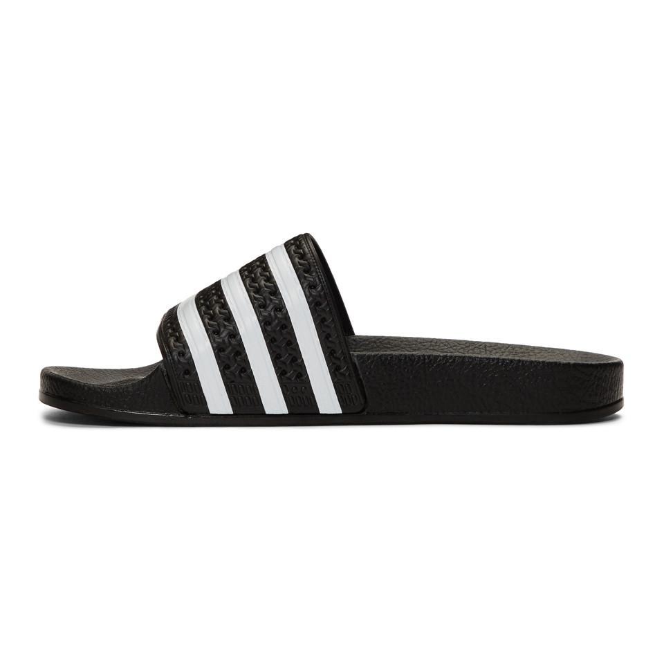 a17dde7d03d284 Adidas Originals - Black And White Adilette Sandals for Men - Lyst. View  fullscreen