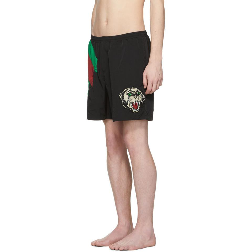 a7b59e3669 Gucci Web Striped And Tiger Head Swimshorts in Black for Men - Lyst