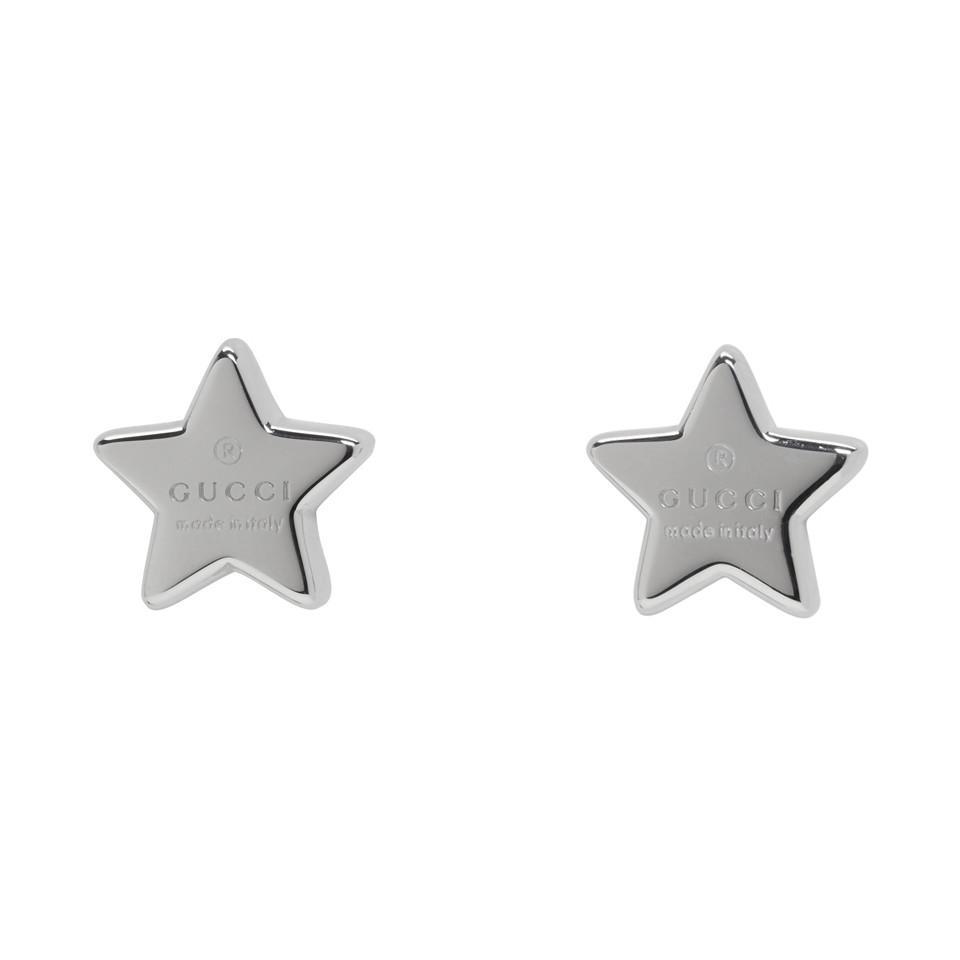 fda115eaf2f Lyst - Gucci Silver Logo Star Earrings