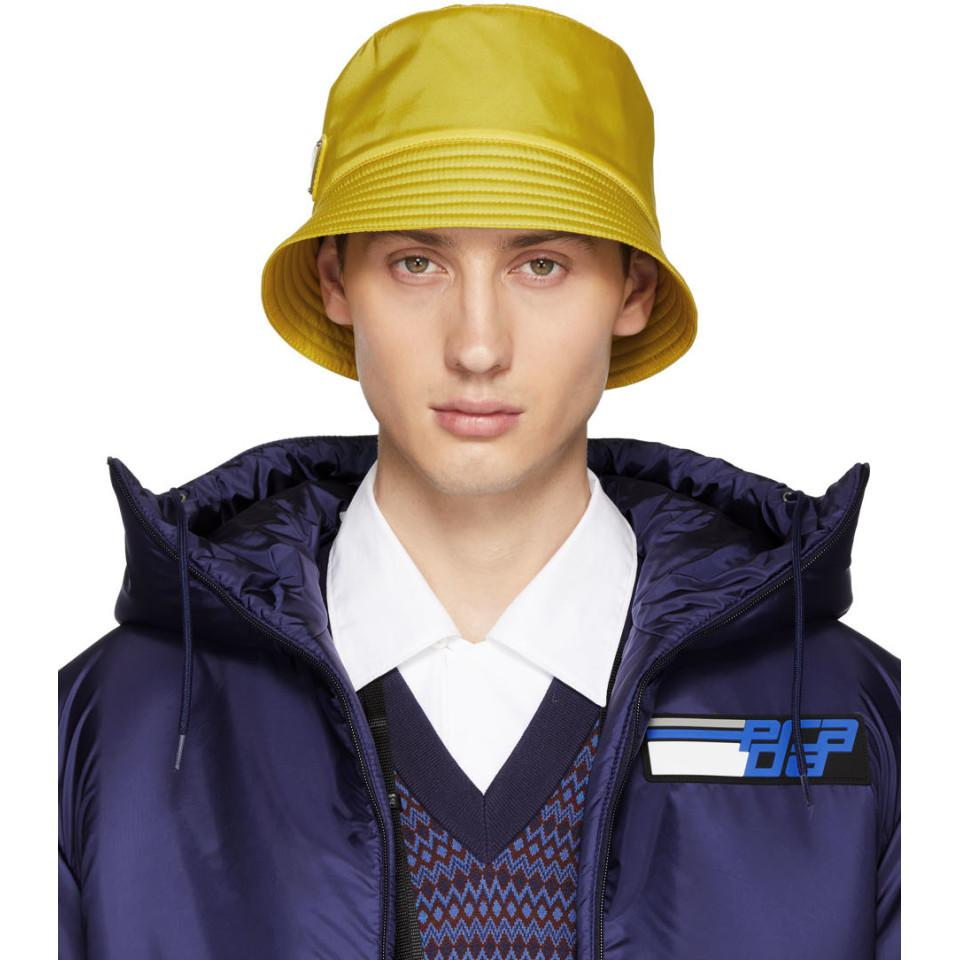 0a2762a3bd9 Lyst prada yellow logo bucket hat in blue for men jpg 960x960 Prada sun hat