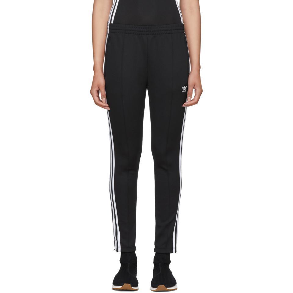lyst adidas originali dei pantaloni della tuta nera in nero