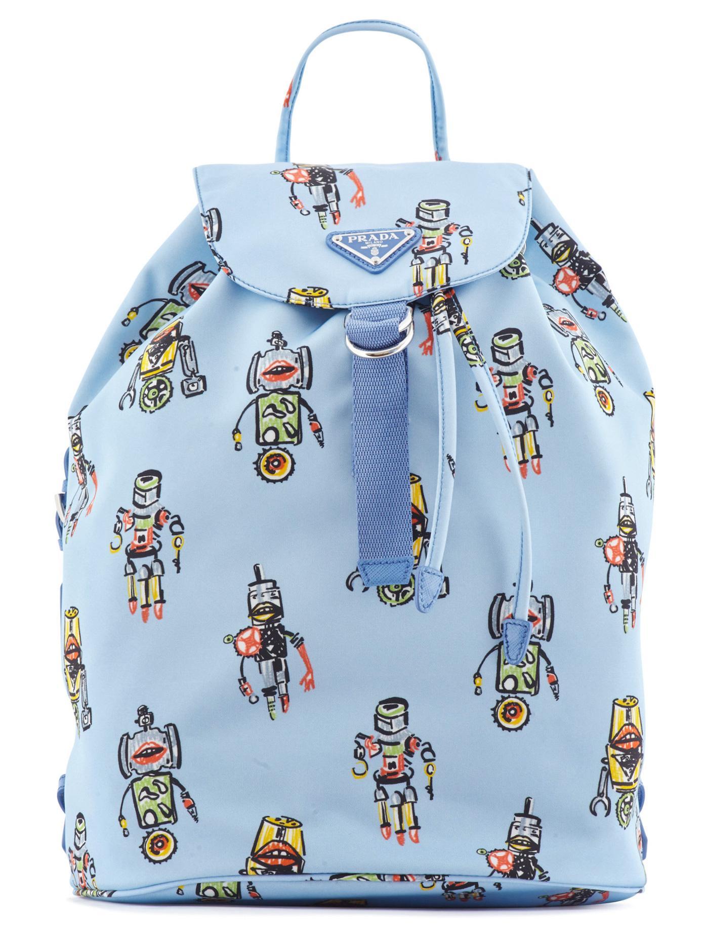 d9b5d4c7c2a5 ... order lyst prada robot print nylon backpack in blue 3ca2b 6e866