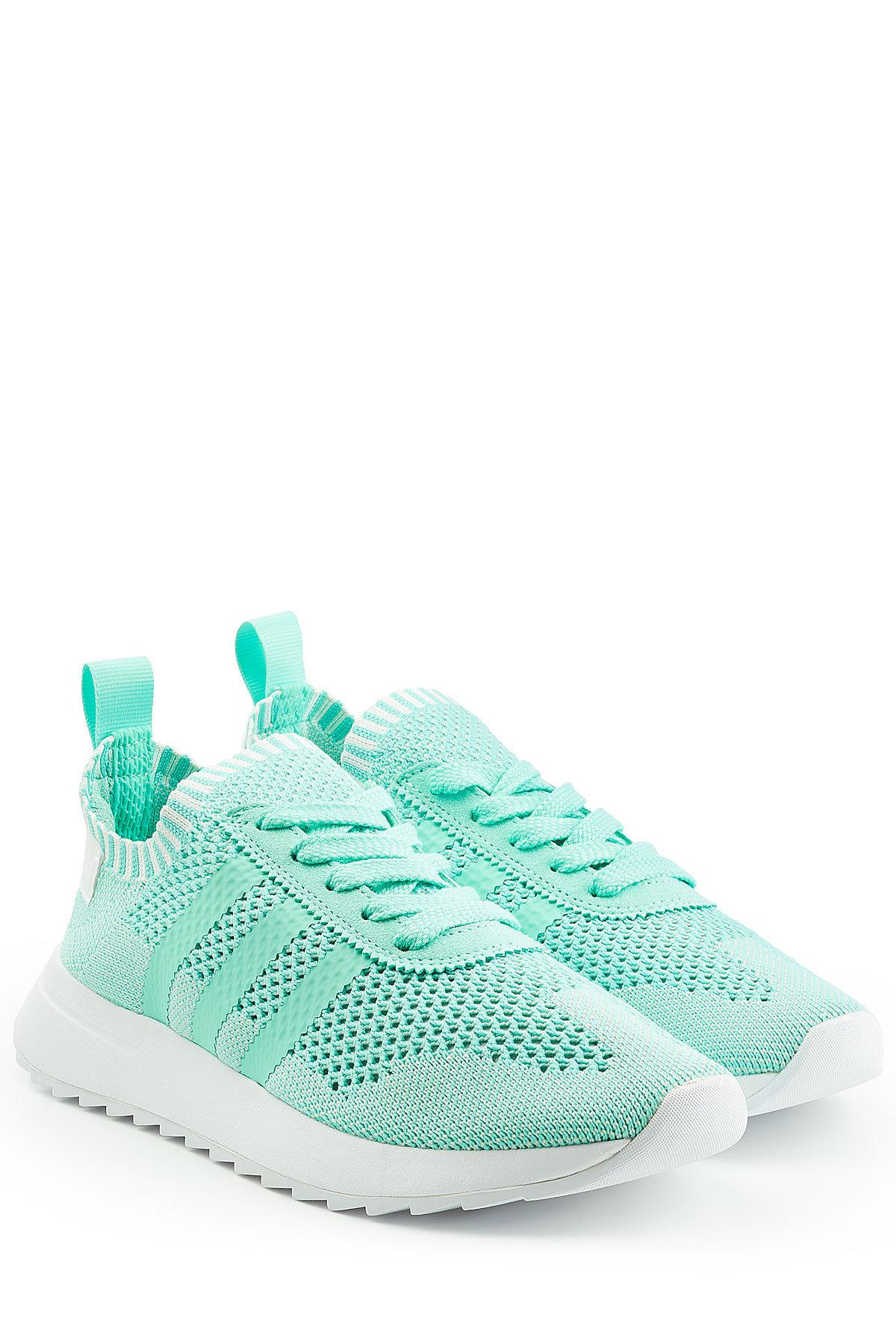 Adidas Originals Primeknit Flashback Sneakers in Green - Save ... aad525e95