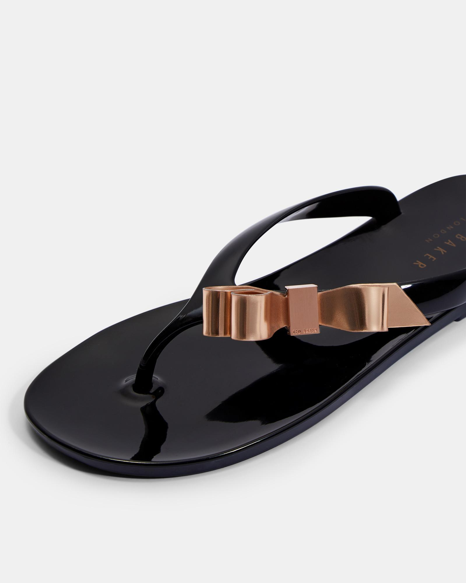 8d9b16ade Lyst - Ted Baker Bow Detail Jelly Flip Flops in Black - Save 52%
