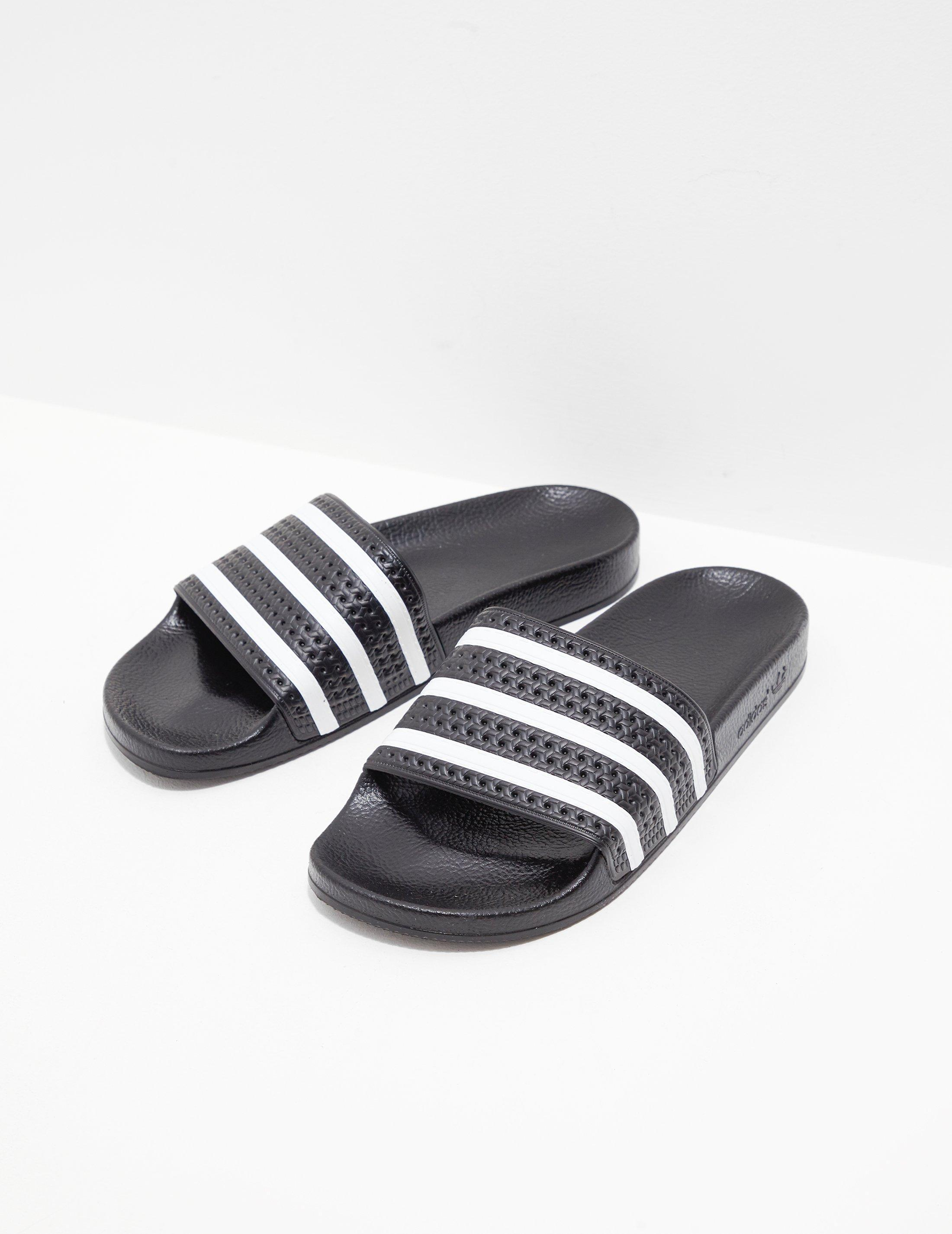 ab6db916f0b66 adidas Originals Mens Adilette Slides Black in Black for Men - Lyst
