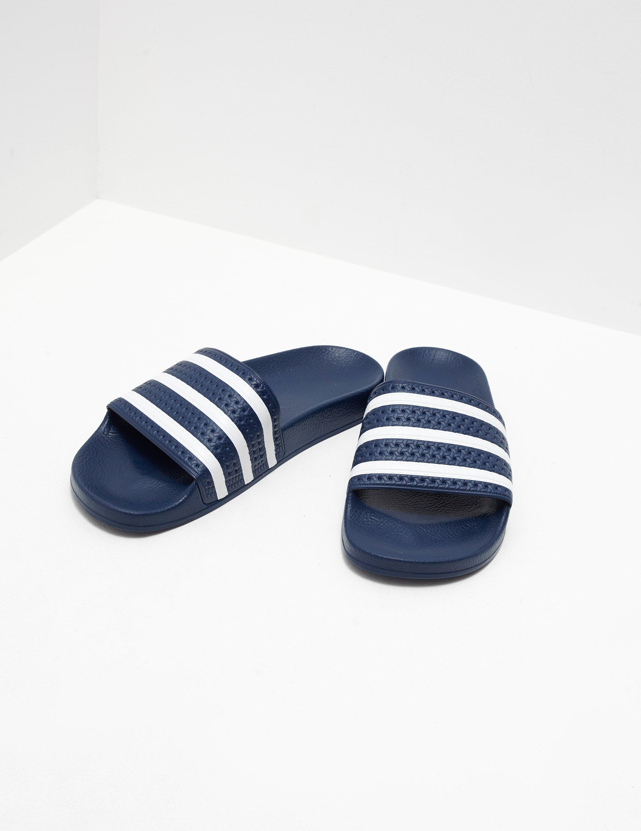 buy popular a7bb4 a92f0 Lyst - adidas Originals Mens Adilette Slides Bluewhite in Bl