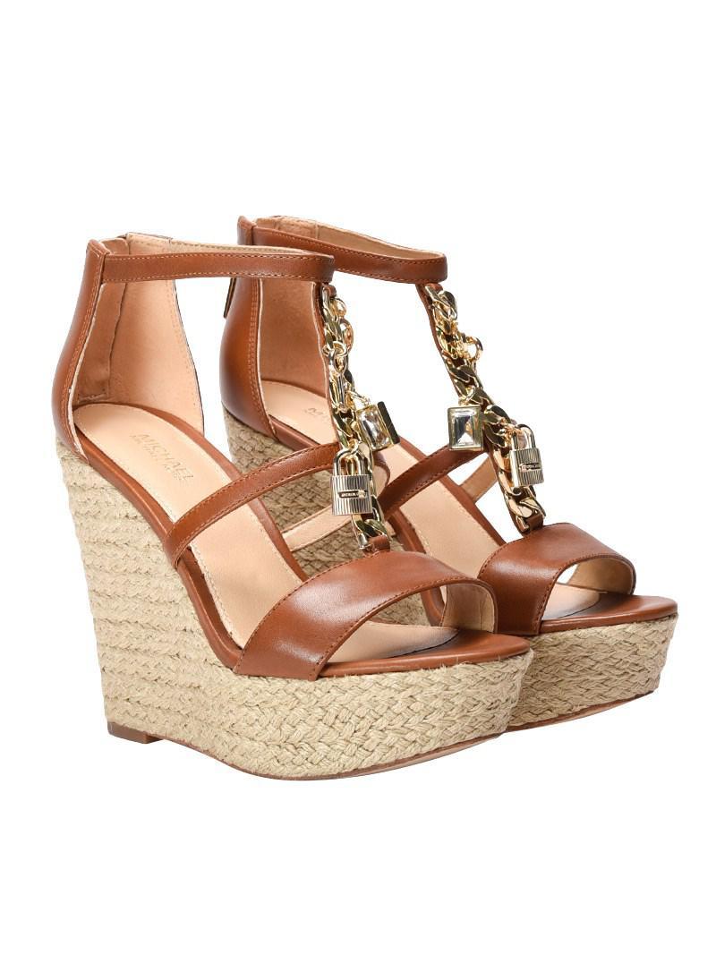 ee2568309e783 Lyst - Michael Kors Suki Wedge Sandals in Brown