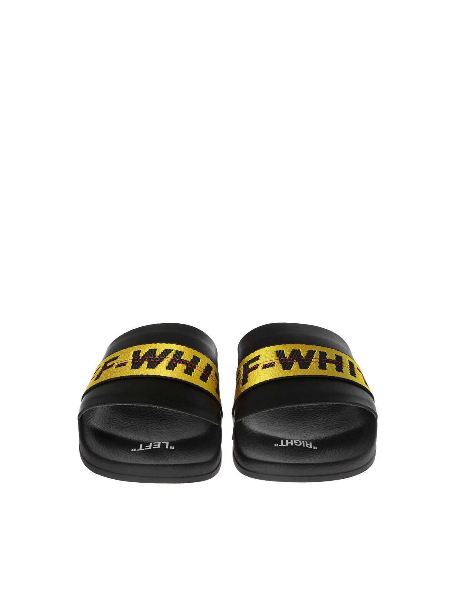a6d4460fb294 ... Virgil Abloh - White Industrial Slider Black Slides for Men. View  fullscreen