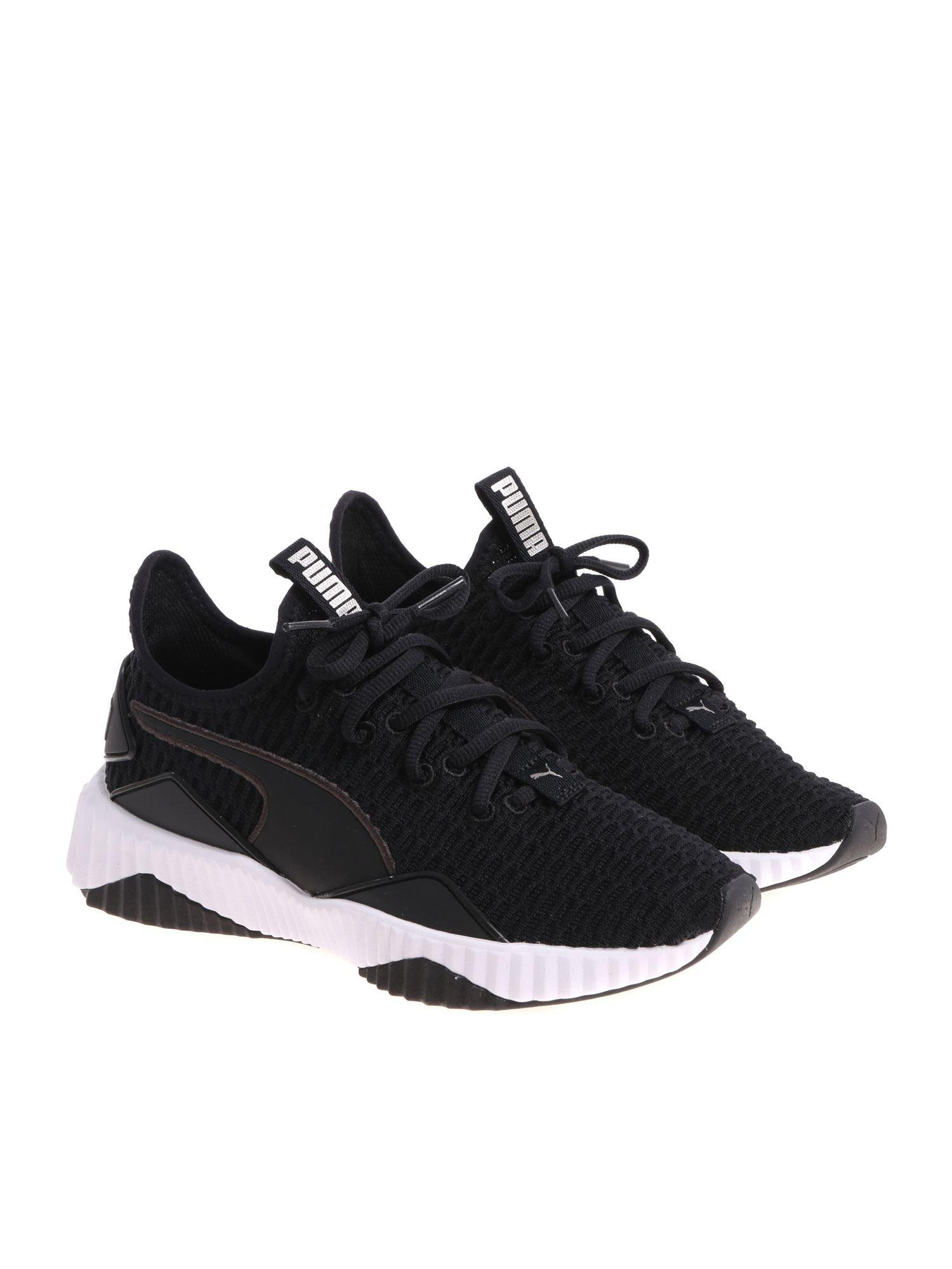 cac4958ae7dbe6 PUMA Black And White Defy Sneakers in Black - Lyst