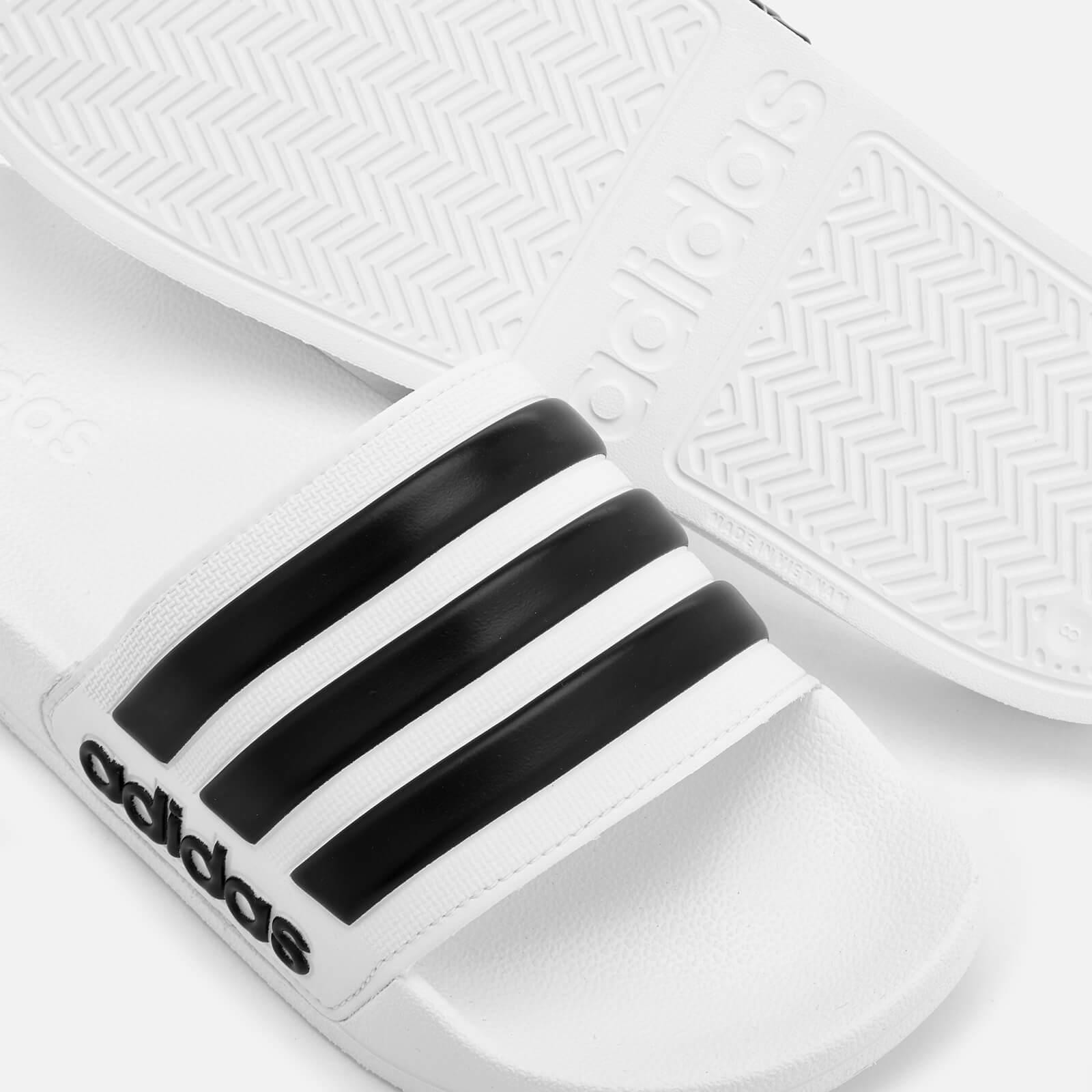 0aab8488389 Adidas - White Adilette Shower Slide Sandals for Men - Lyst. View fullscreen