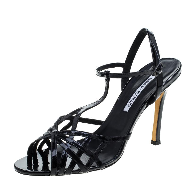 8f8fbf61eda Manolo Blahnik. Women s Black Patent Leather Cut Out T Strap Sandals ...
