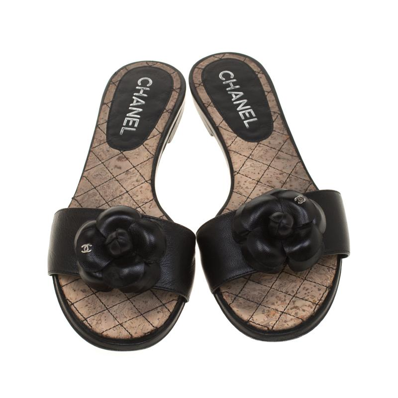 a2fdeef6a48c Chanel - Black Leather Camellia Embellished Cc Flat Slides Size 38 - Lyst.  View fullscreen