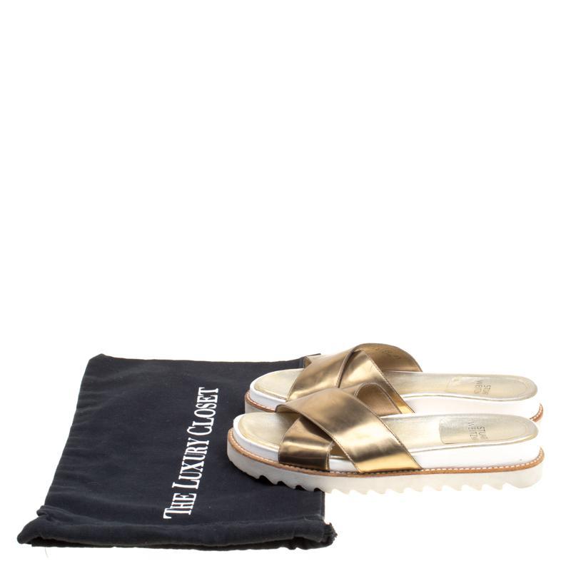 2d9c83cea9e0 Lyst - Stuart Weitzman Metallic Leather Crisscross Slides Sandals in ...