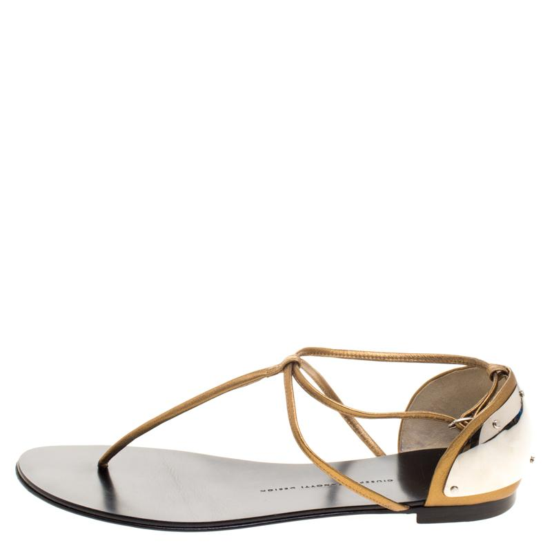 1ba2ddbd12add6 Giuseppe Zanotti - Metallic Bronze Leather T-strap Flat Sandals - Lyst.  View fullscreen