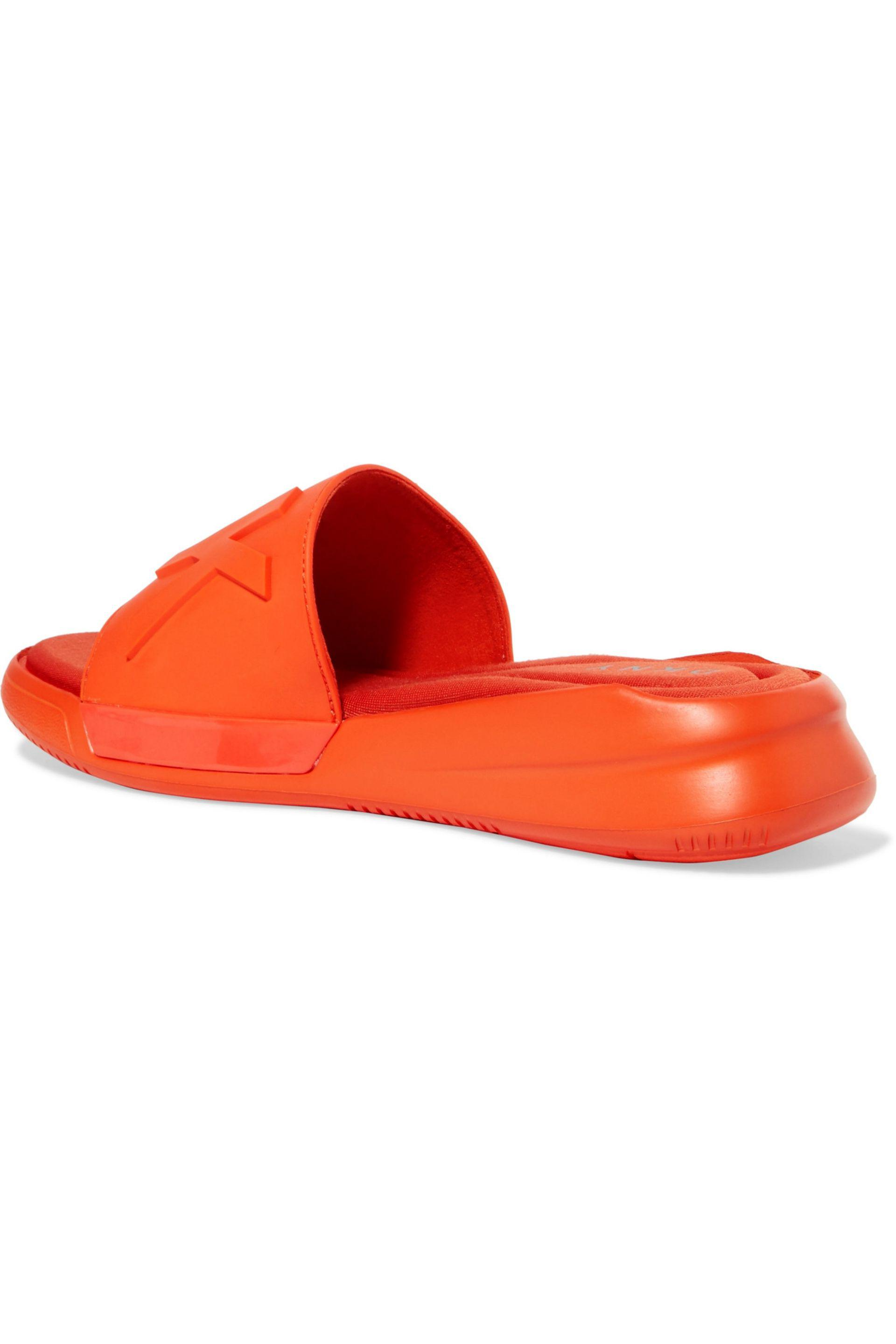 2503cb33e247a DKNY Embossed Rubber Sandals in Orange - Lyst
