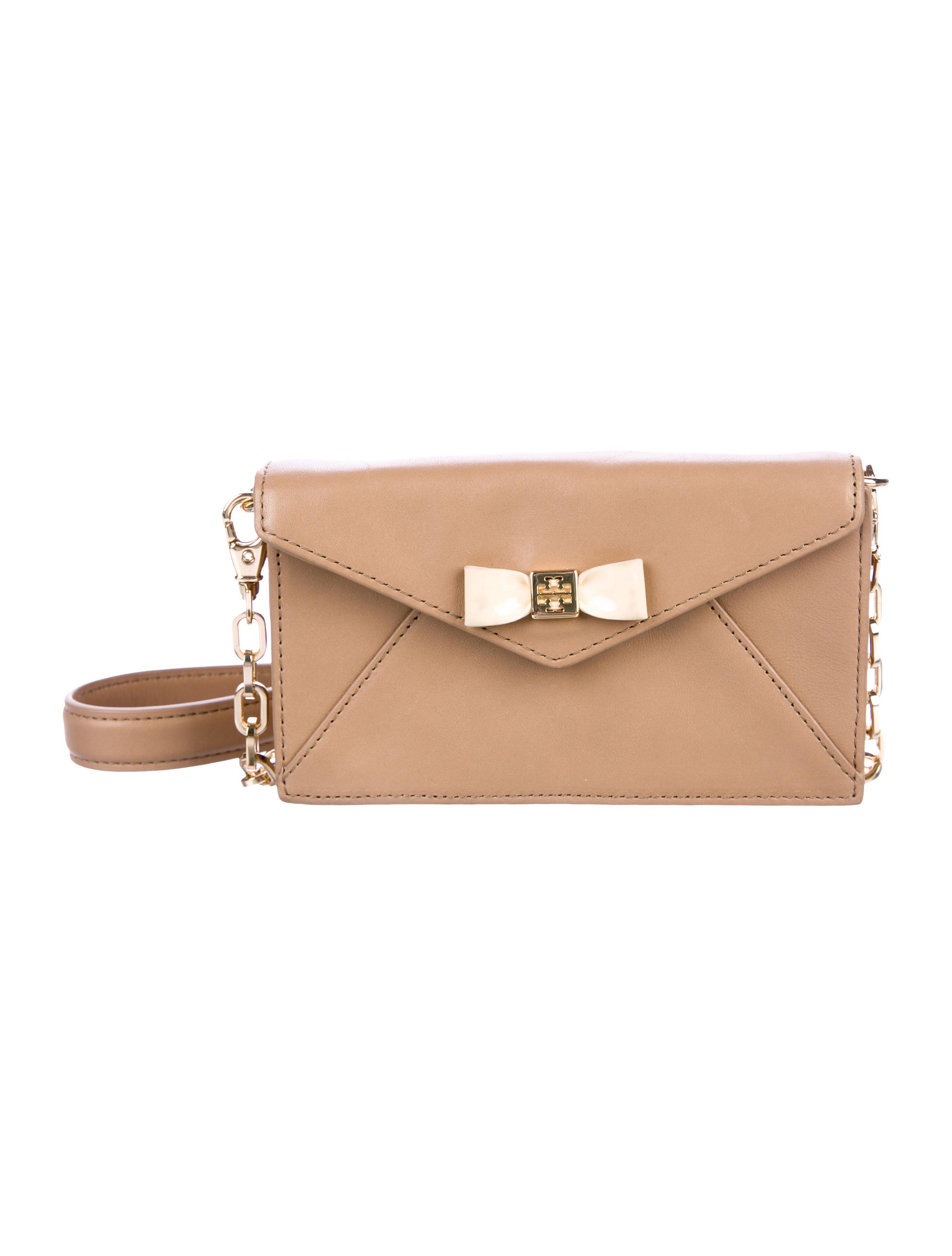 43fcd589f09 Lyst - Tory Burch Bow Envelope Crossbody Bag Gold in Metallic