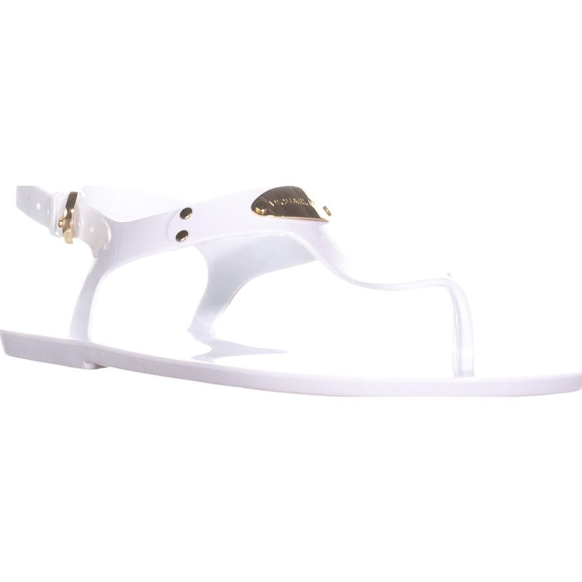 53ba67b05c574 Lyst - Michael Kors Mk Plate Jelly Thong Sandals in White