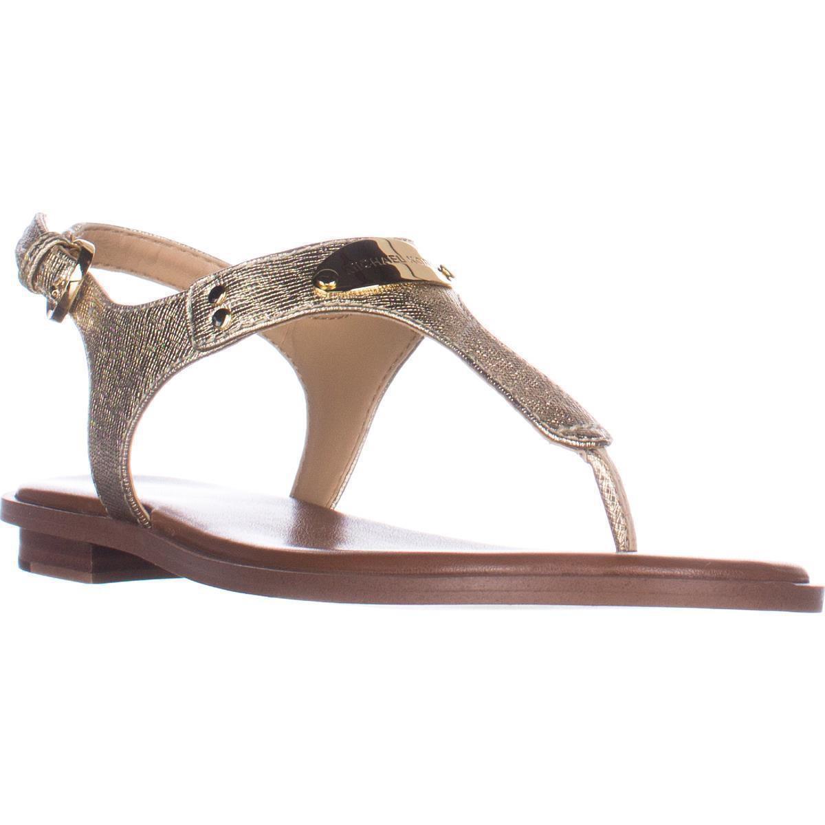 91411bfb4c14 Lyst - Michael Kors Plate Thong Logo Thong Flat Sandals in Metallic