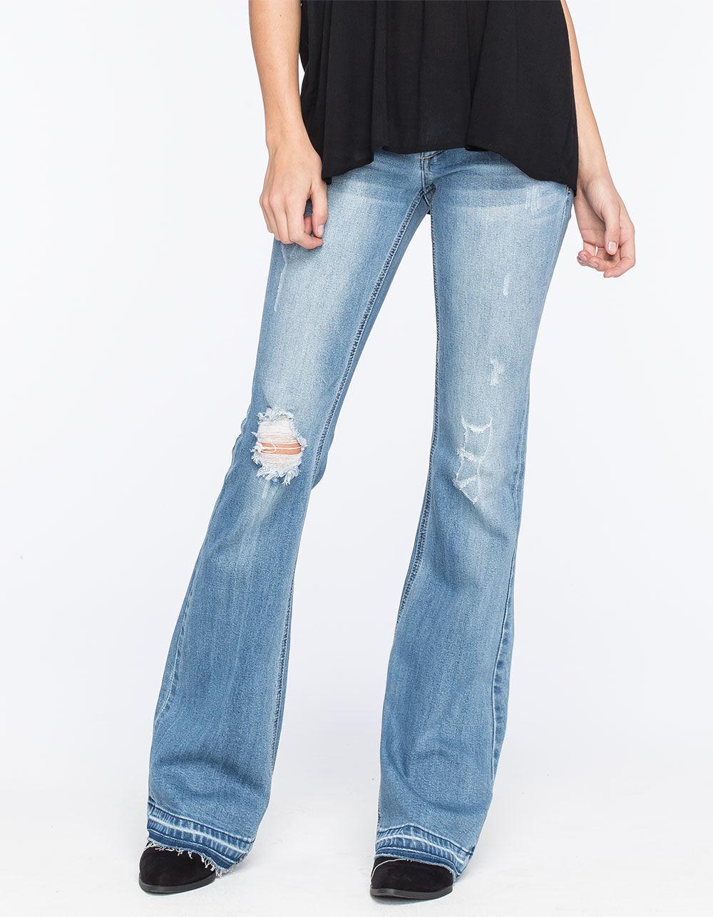 b0907c6482c Lyst - Celebrity Pink Raw Hem Womens Flare Jeans in Blue