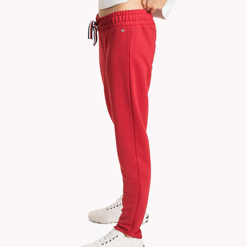 8c9a58d9600 Tommy Hilfiger Signature Tape Joggers in Red - Lyst