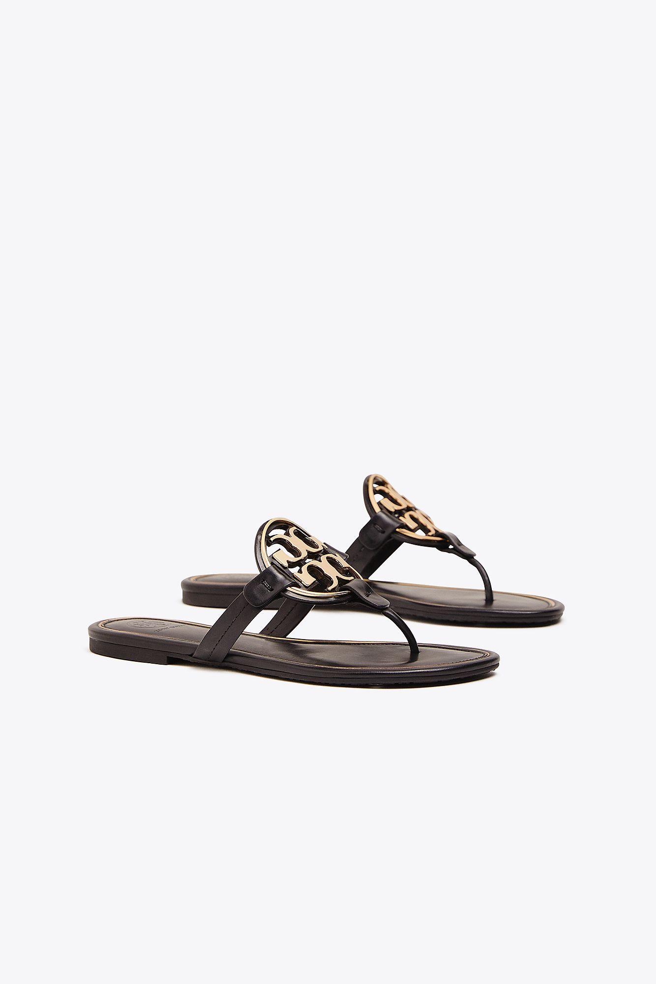 d8830a603cc5a7 Tory Burch Miller Flat Metal Logo Slide Sandals in Black - Lyst