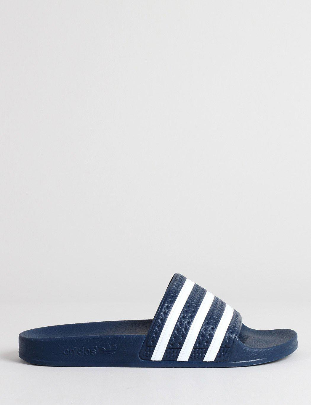 13c35d06c632 Adidas Originals Adilette Textured-rubber Slides in Blue for Men ...