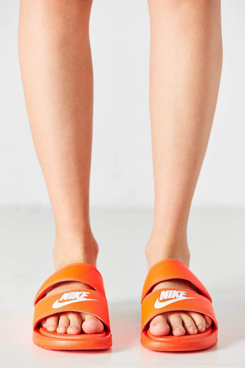 a4acb4f60 Gallery. Previously sold at  Urban Outfitters · Women s Nike Benassi