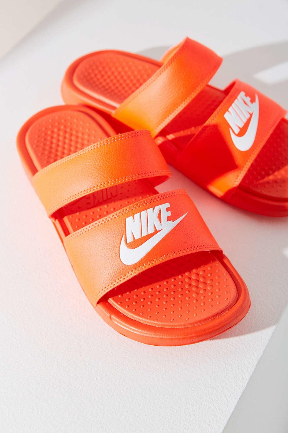 nike benassi duo ultra slide in orange lyst