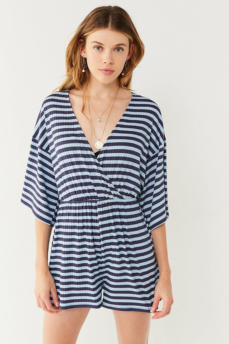80063b7beaa5 Lyst - Urban Outfitters Uo Ribbed Knit Surplice Romper in Blue