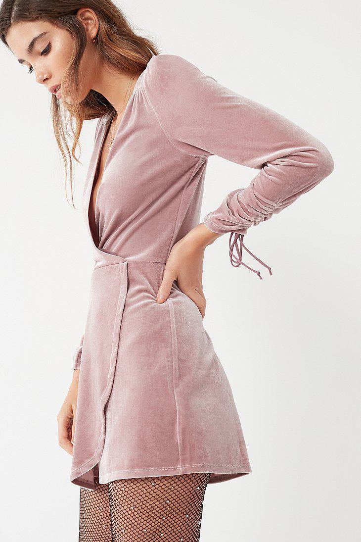 05e7be475da Lyst - Urban Outfitters Uo Goldmine Velvet Surplice Romper in Purple