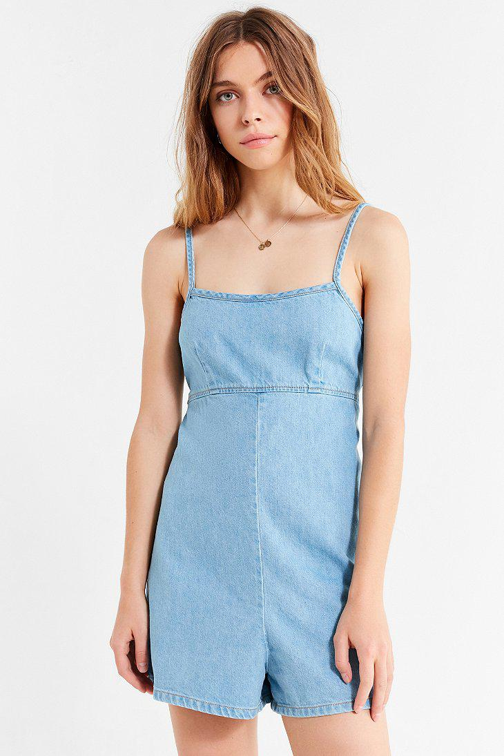 3e1375174bfd Lyst - Urban Outfitters Uo Empire Waist Denim Romper in Blue