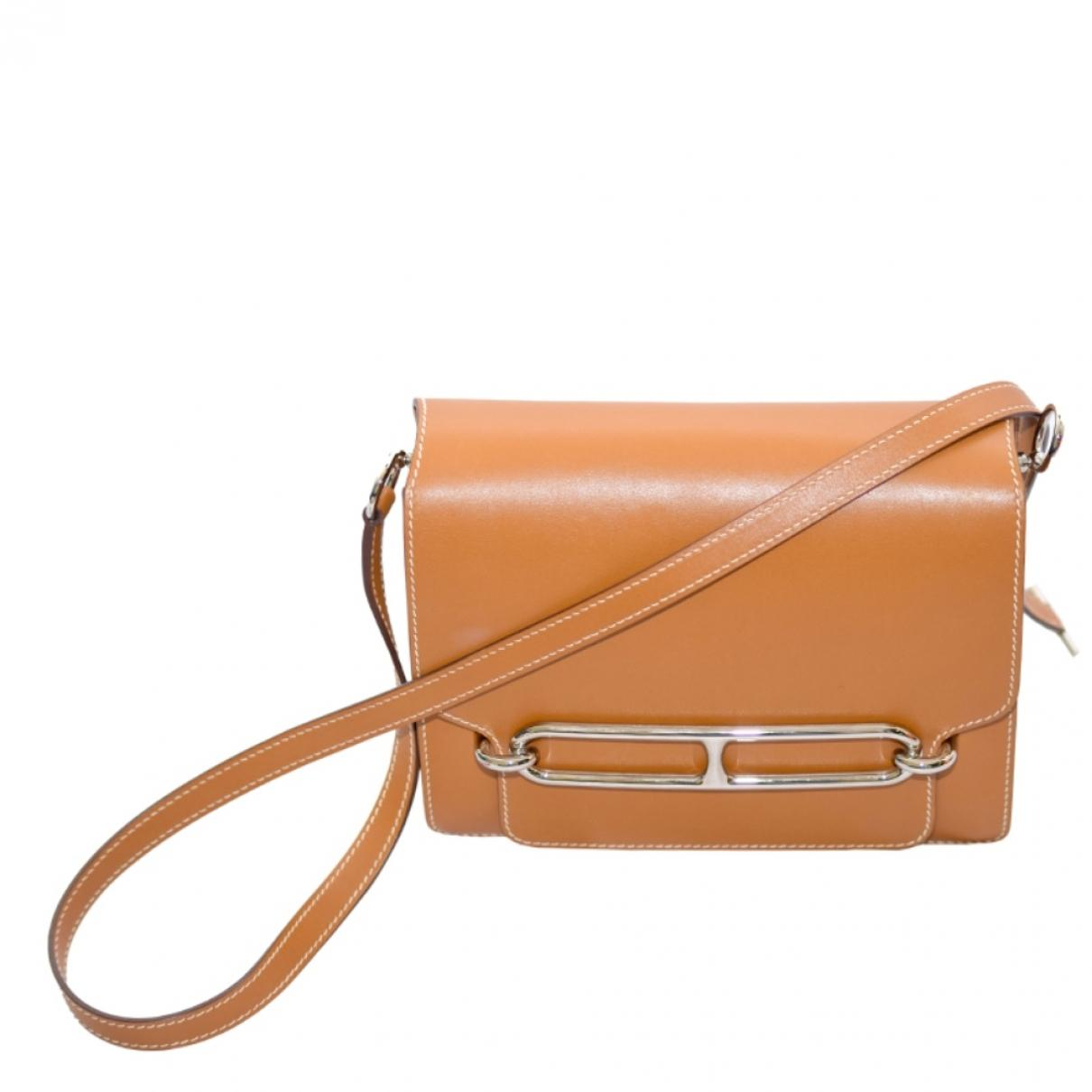 2e3946e06eb4 Lyst - Hermès Roulis Brown Leather Handbag in Brown