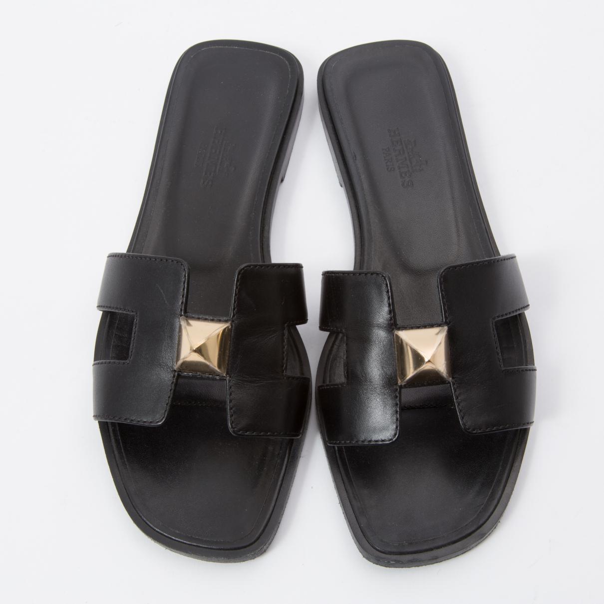 beaucoup de styles conception de la variété se connecter Mules Oran en cuir Cuir Hermès en coloris Noir - Lyst