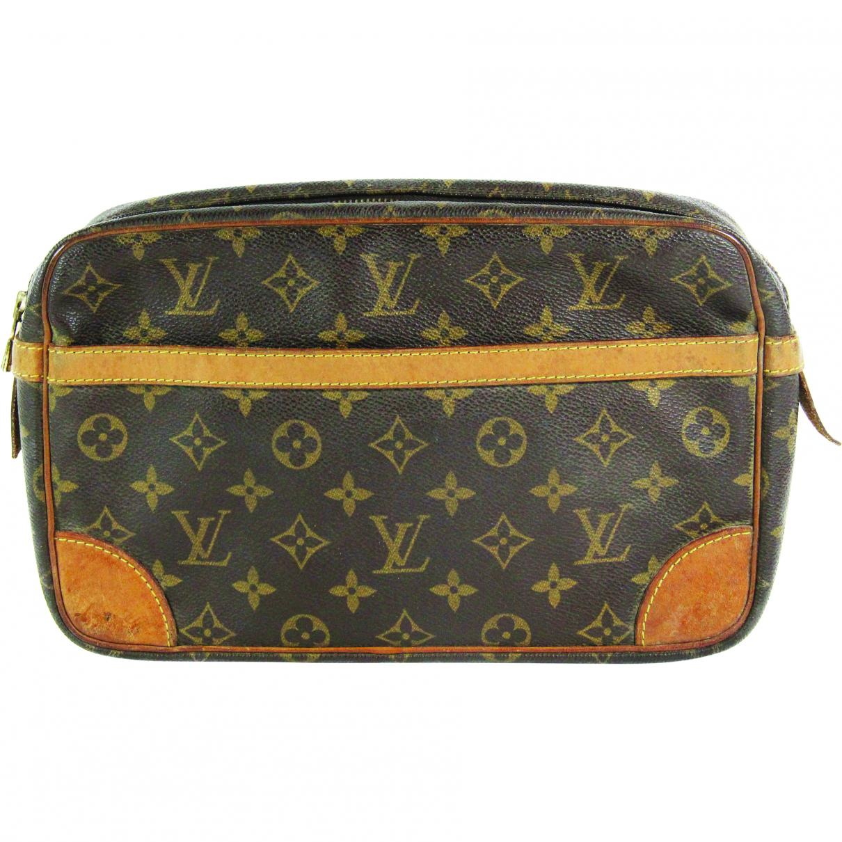 fc849fed9684 Louis Vuitton. Women's Pre-owned Vintage Brown Cloth Clutch Bags. $249 From Vestiaire  Collective