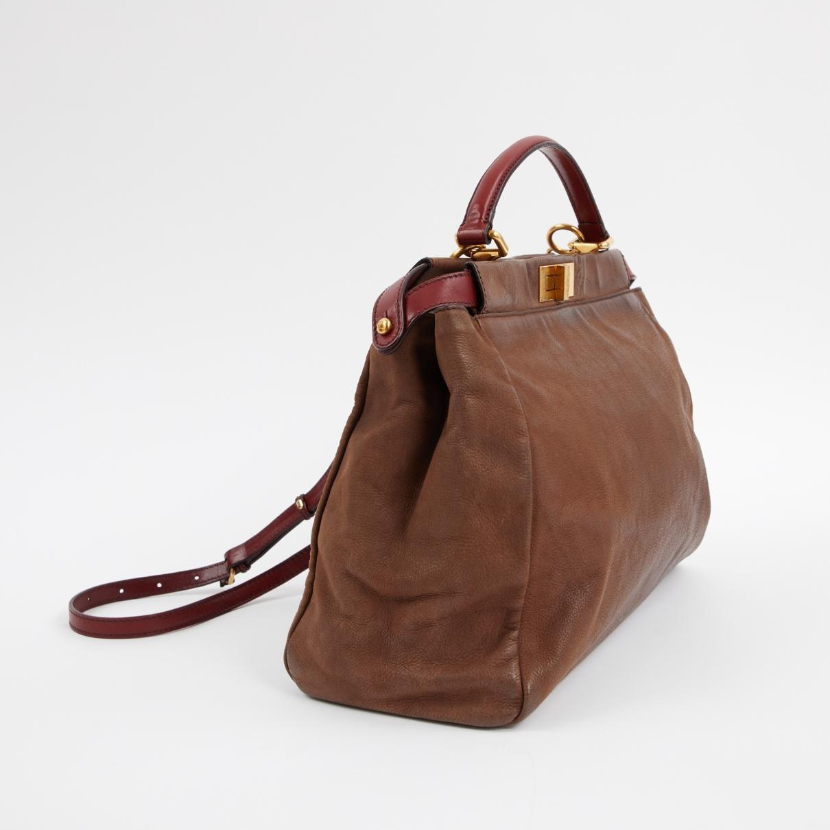 ec8509beff7a Fendi - Pre-owned Peekaboo Brown Leather Handbags - Lyst. View fullscreen
